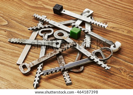 Heap of transom (rack and pinion) the keys to the door on wooden background