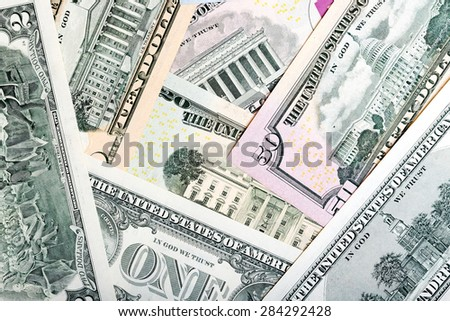 Heap of U.S. dollars, money background. - stock photo