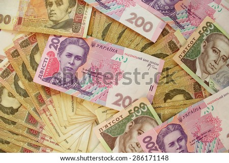heap of Ukrainian money in cash of different value - stock photo