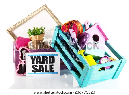 Heap of unwanted stuff ready for yard sale isolated on white - stock photo