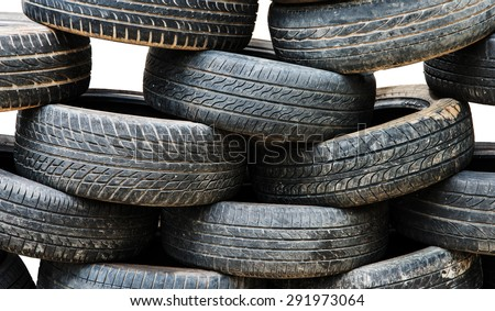 Heap of used tyre on white background - stock photo