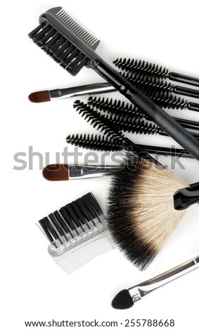 Heap of Various Make-up Brushes and Applicators closeup on white background. Top View - stock photo