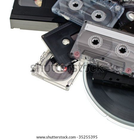 Heap of various vintage audio and video cassettes on white background - stock photo