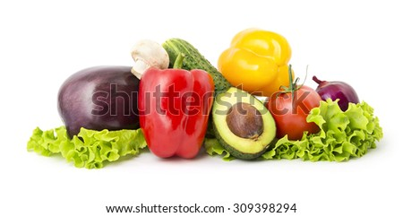 Heap of vegetables on fresh salad leaves isolated on white background - stock photo