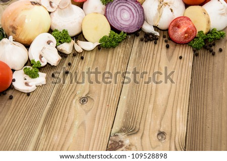 Heap of Vegetables on wooden background - stock photo