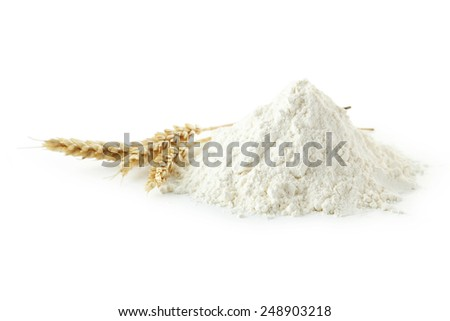 Heap of wheat flour with spikelets isolated on white - stock photo