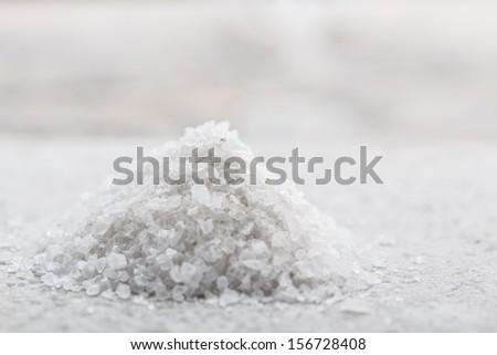 Heap of white crystal salt - stock photo