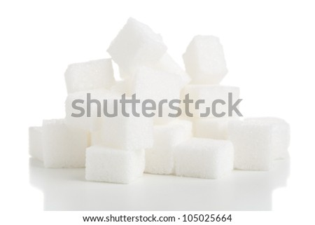 Heap of white sugar cubes over white background - stock photo