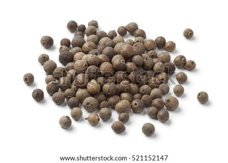 Heap of whole allspice berries on white background
