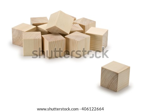Heap of wooden cubes and separate wooden cube it is isolated on white