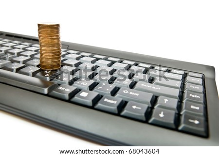 Heap of yellow coins on black keyboard