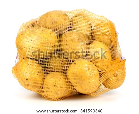 Heap of yellow raw potatos in red string bag. Isolated on white background. Close-up. Studio photography. - stock photo