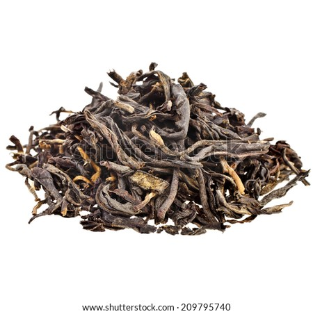 Heap pile of dry black tea leaves Dian Hong  isolated on white background