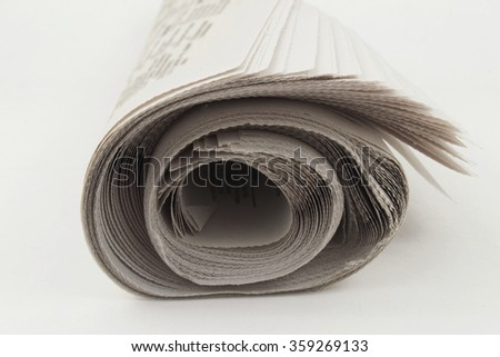 Heap rolls of newspapers