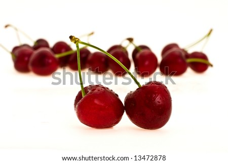 heap to ripe sweet cherries on white background