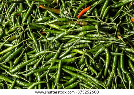 heaped pile of green chillies - stock photo