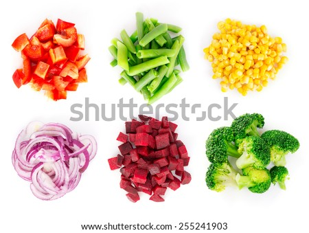 Heaps of different cut vegetables isolated on white background. Top view.