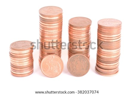 Heaps of five cents copper coins of the South African currency Rand. Image isolated on white studio background.