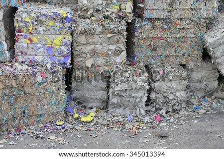 heaps of waste paper in the paper mill for the production of recycled paper - stock photo