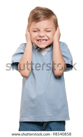 Hear no evil - Portrait of funny little boy over white background - stock photo
