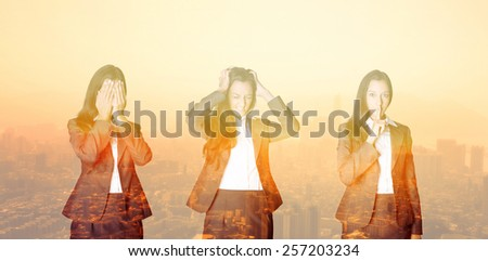 Hear no evil, Speak no evil, See no evil conceptual image of a businesswoman covering her eyes, ears and mouth in three poses against an overlaid surreal orange cityscape sunset - stock photo
