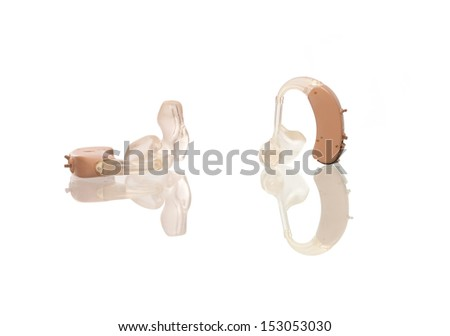 Hearing aids isolated on white with their reflections - stock photo