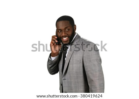 Hearing good news. Afroamerican manager has good news. Pleasant talk on the phone. Friendly phone conversation. - stock photo