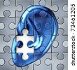 Hearing impairment and human ear symbol on a jigsaw puzzle  representing a medical listening condition that results in a deafness. - stock photo