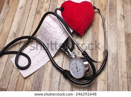 Heart analysis, electrocardiogram graph (ECG), red heart - stock photo