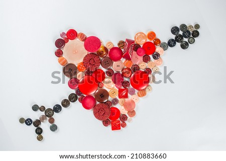 heart and arrow in colored buttons - stock photo