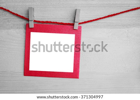 heart and blank paper card on wooden background, Selective red color.