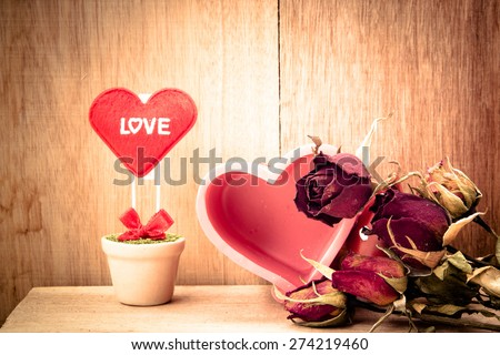 heart and dry roses for my love on wood background,vintage color tone,valentine day,still life - stock photo
