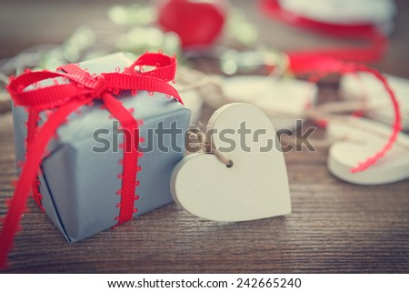 heart and gift  on wooden board for valentines day - stock photo