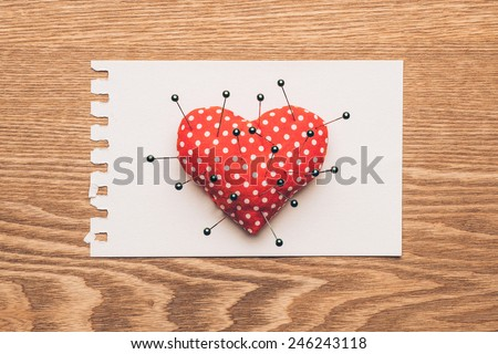heart and needles with note on wooden background. Vintage style. Valentines day concept