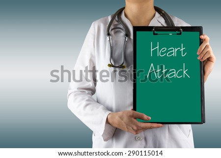 Heart Attack - Female doctor's hand holding medical clipboard and stethoscope on blue blurred background. Concept of Healthcare And Medicine. Copy space - stock photo