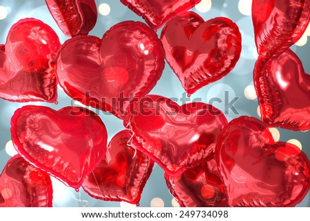 Heart balloons against white glowing dots on blue