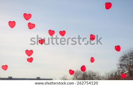 Heart balloons in front of blue sky - stock photo
