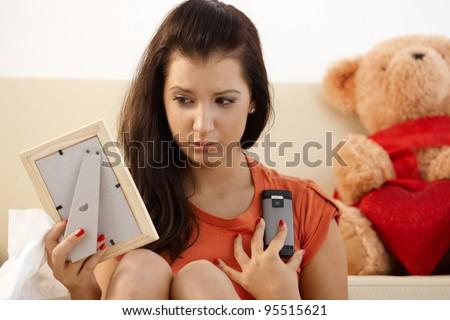 Heart-broken teenage girl looking sad at home.? - stock photo