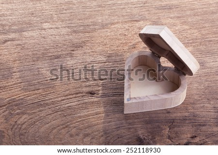 heart brown wood box on wood background, abstract love background - stock photo