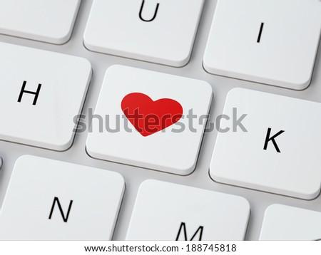 Heart button on white modern keyboard. - stock photo