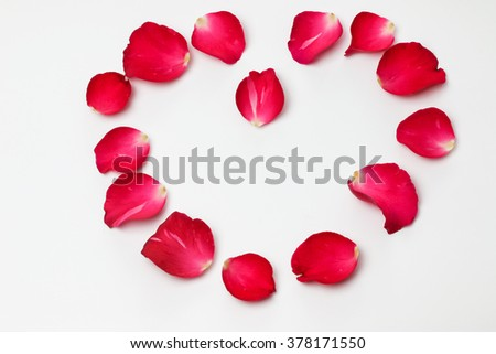 Heart by rose petals on white background, love concept.