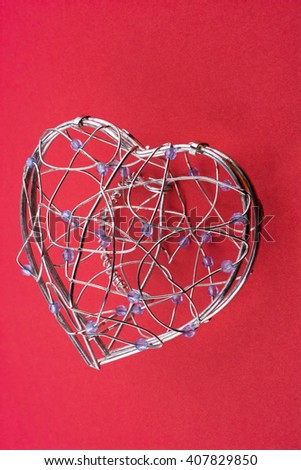 Heart cage on a red background - stock photo