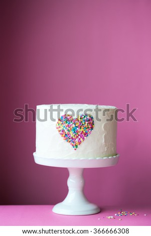 Heart cake on a pink background - stock photo