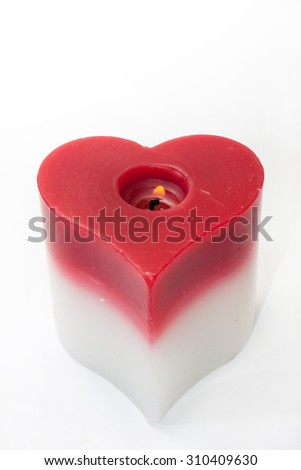 Heart candle on the white background. - stock photo