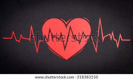 heart cardiogram on a black background paper - stock photo