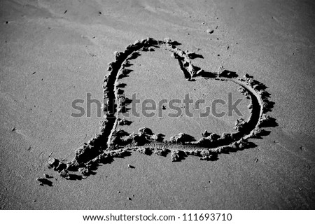Heart Carved in the Sand - stock photo