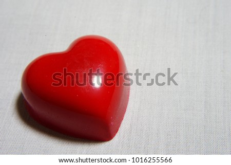 https://thumb1.shutterstock.com/display_pic_with_logo/167494286/1016255566/stock-photo-heart-chocolate-for-valentine-day-1016255566.jpg