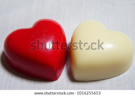 https://thumb1.shutterstock.com/display_pic_with_logo/167494286/1016255653/stock-photo-heart-chocolate-for-valentine-day-1016255653.jpg