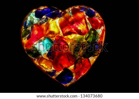Heart - closeup of back lit stained glass - stock photo