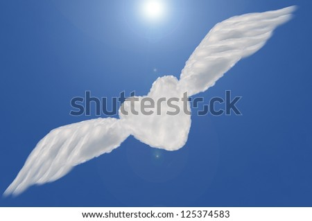 heart cloud shape with wing  on blue sky